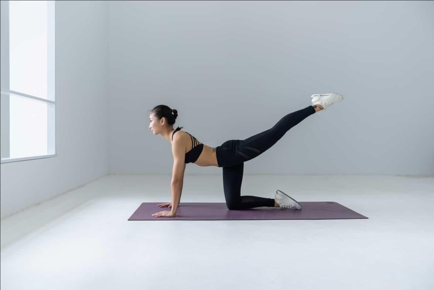 performing yoga pose